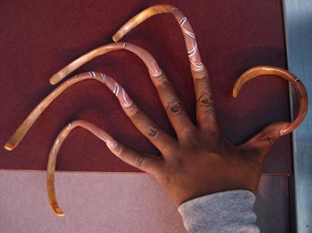 Unwieldy Long Fingernails on Women