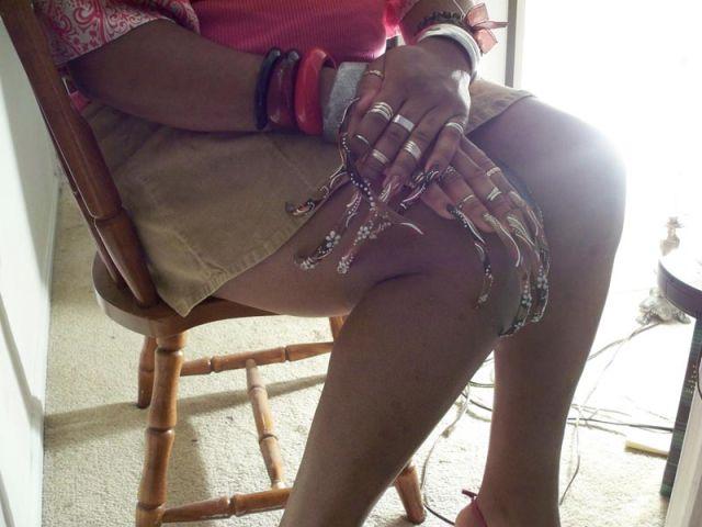 Unwieldy Long Fingernails on Women