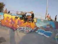Just a Guy Riding a Scooter in Skate Park