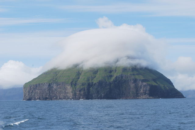 An Amazing Island with a Crown of Clouds