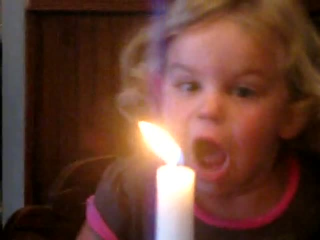 Little Girl vs Candle. Priceless