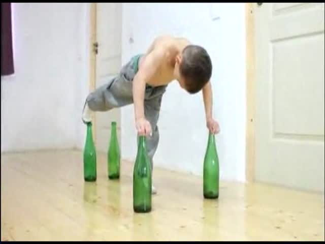 Strongest Kid in the World Does Push-Ups on Bottles