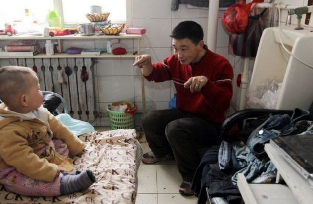 Chinese Family Lives in Abandoned Toilet