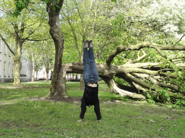 Young Woman Does Handstands for Good Cause