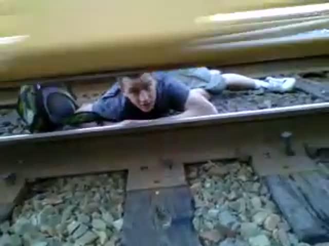 Insane Jump from Under Train