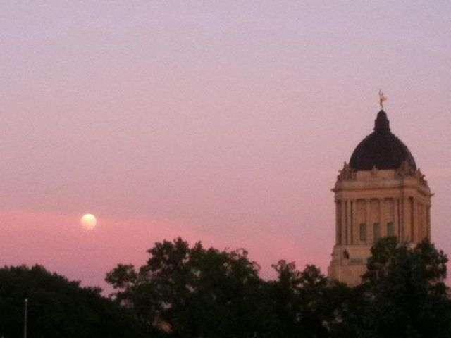 Moon Rising in Winnipeg, Manitoba, Canada