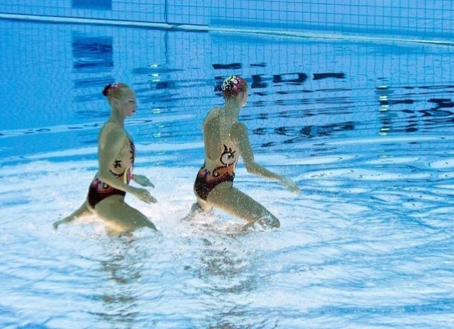 Synchronized swimming seen from a fresh angle 13 pics - Swimming pool wardrobe malfunction pics ...