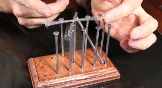 How to Balance 14 Nails on a Single Nail Head