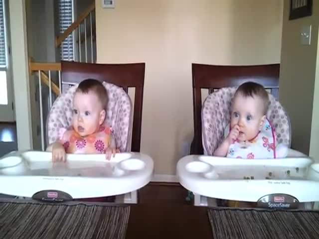Twin Babies' Funny Reaction to Daddy Playing Guitar