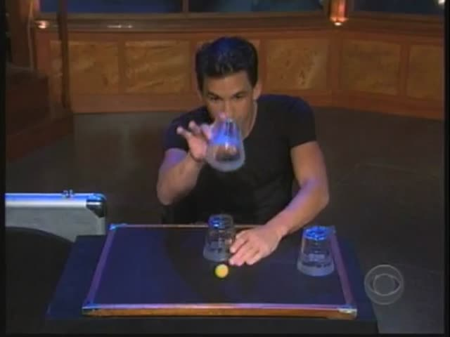 World Champion of Magic Performs Amazing Transparent Cups and Balls Trick