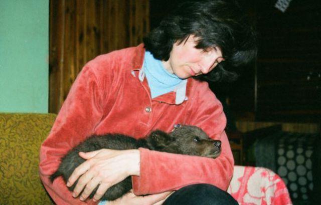 Latvian Woman Raises Wild Bear Cub Alongside Her Children