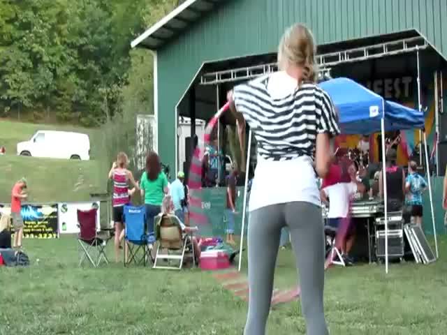 Cute Girl Hula Hooping in Yoga Pants
