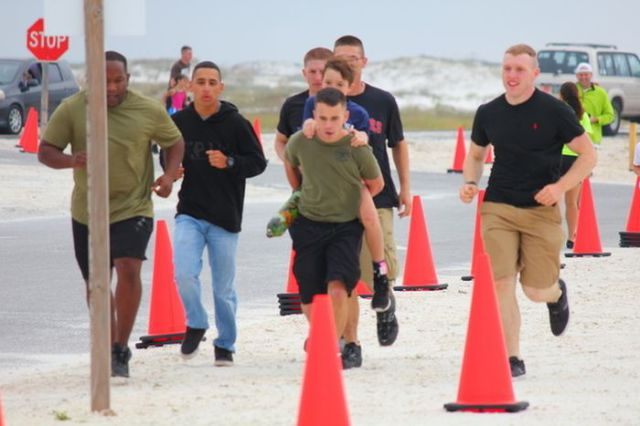 Marines Carry Boy to Victory!