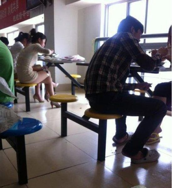 This Chinese Girl Enjoys Her Lunch in Student Cafeteria