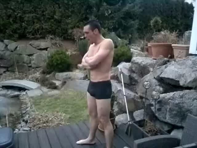 German Dude Jumps into Frozen Pool