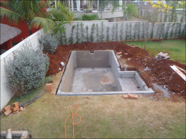 Diy swimming pool conversion 26 pics for Swimming pool koi pond conversion