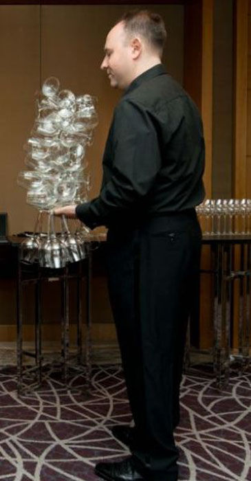 Wine Expert Sets World Record for Holding Wine Glasses!