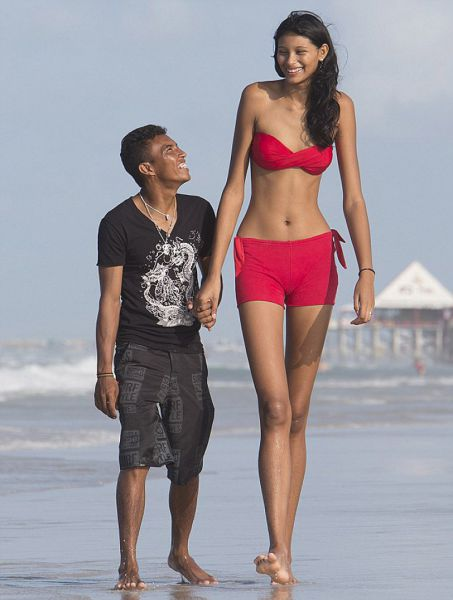 Teen Girl Towers Over Her Lover
