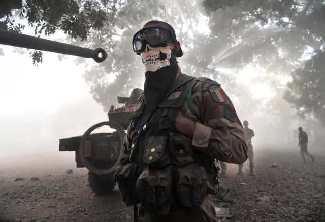 Photo of Masked Soldier Causes Public Outcry