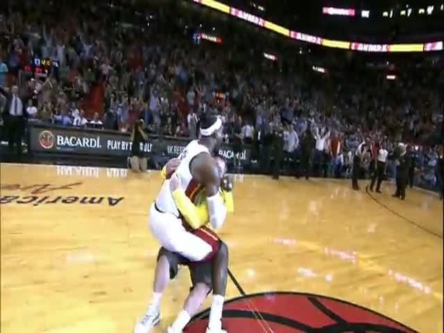Awesome NBA Moment: LeBron Tackles Fan Who Just Hit $75,000 Shot