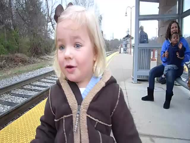Adorable 3-Year-Old Girl Discovers Trains