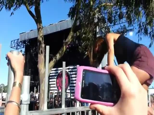 Girl Wedges Herself Climbing over a Fence
