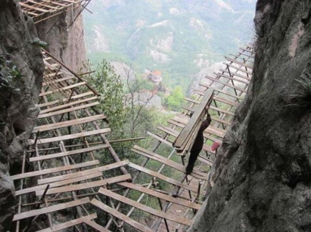 It's Hazardous Work for Chinese Mountain Road Builders