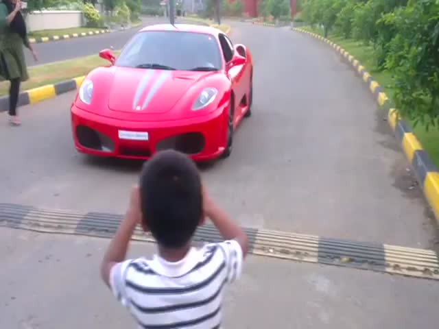 Isn't He a Little Bit Young to Drive a Ferrari F430?