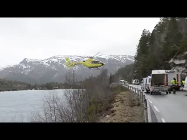 Helicopter Balances on Safety Barrier after Car Accident in Norway
