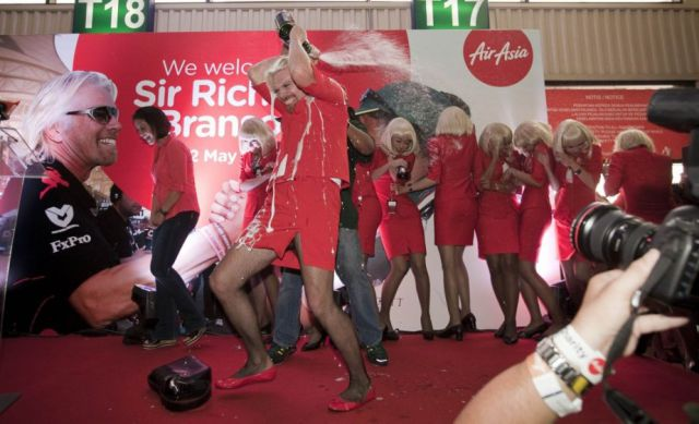 Richard Branson Dresses in Drag to Serve Flight Passengers…