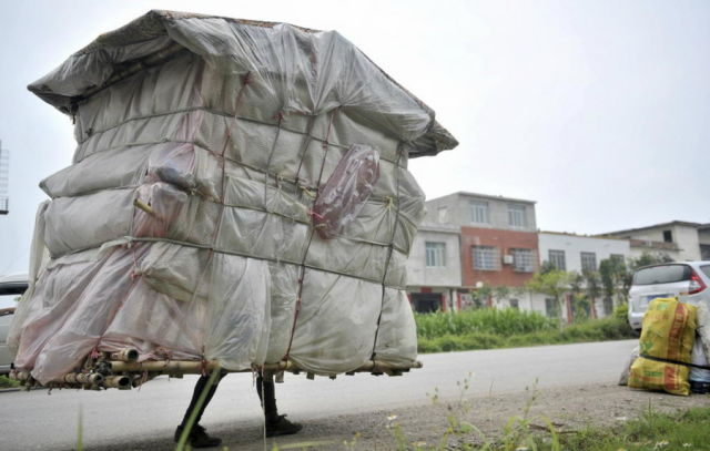 A Chinese Man Who Walks around with His House