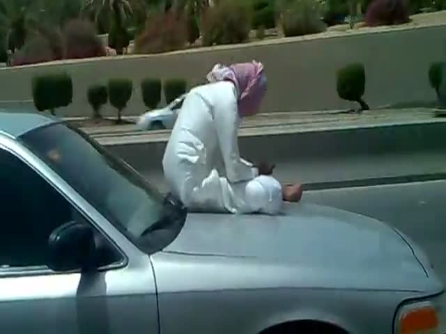 Saudi Guy Texting on His Car's Hood Because YOLO!