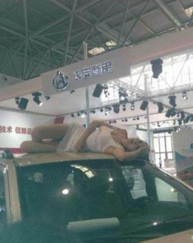 A Chinese Auto Show Model Who Really Earns Her Salary