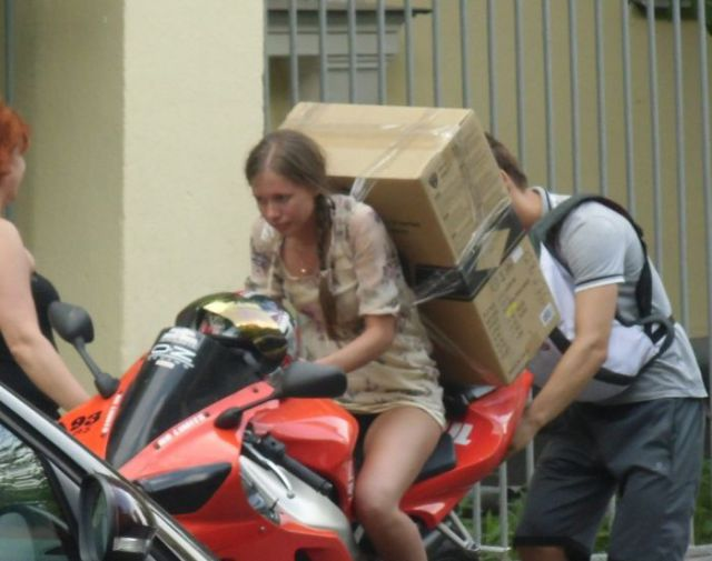 An Interesting Solution for Moving a Big Item on a Sports Bike