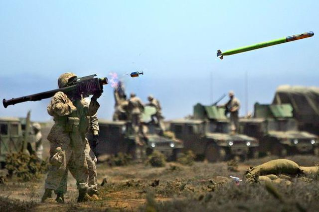 Up Close and Personal with Military Men and Their Weapons