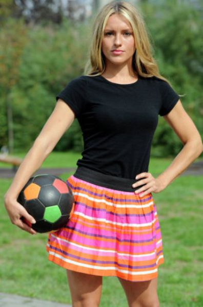 This Blonde Bombshell Is a Football Fanatic