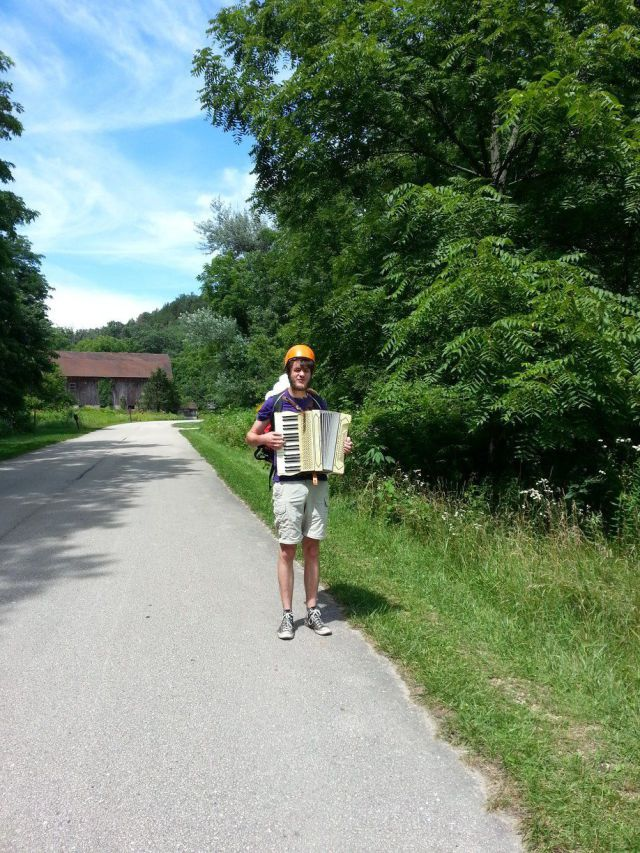 Mountain Climbing Accordian Playing Hiker
