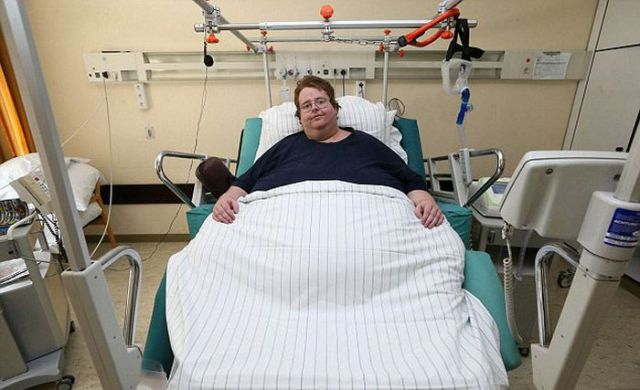 It Takes More Than Just Firemen to Rescue This Obese Man