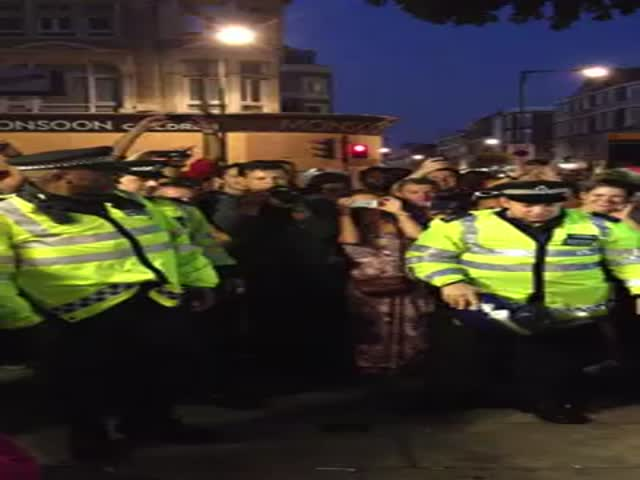 Funny Not So Serious Cops Give Crowd an Impromptu Dance-Off
