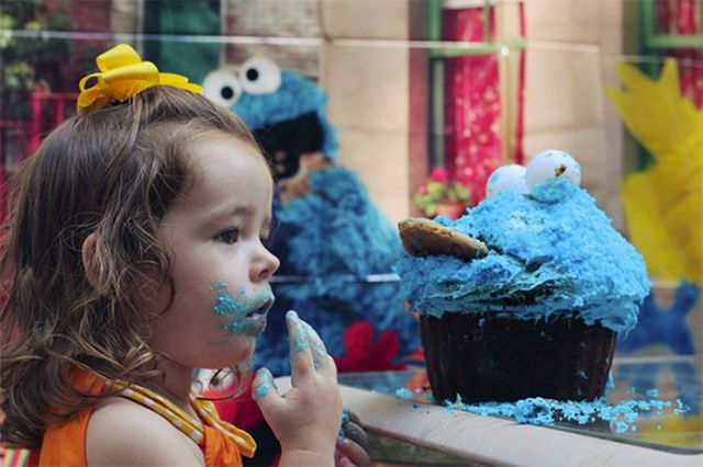 Cute Girl Demolishes Her Cookie Monster Cake