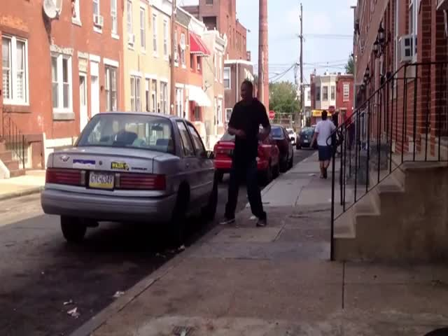 Weird Guy Attacks Car, Knocks Himself Out!