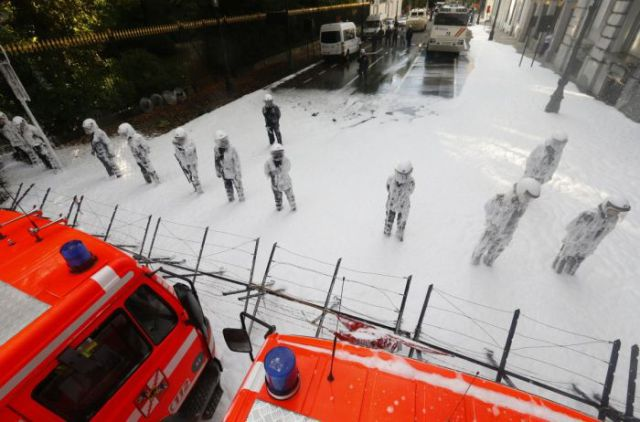 Belgian firefighters Stand-Off Against Riot Police