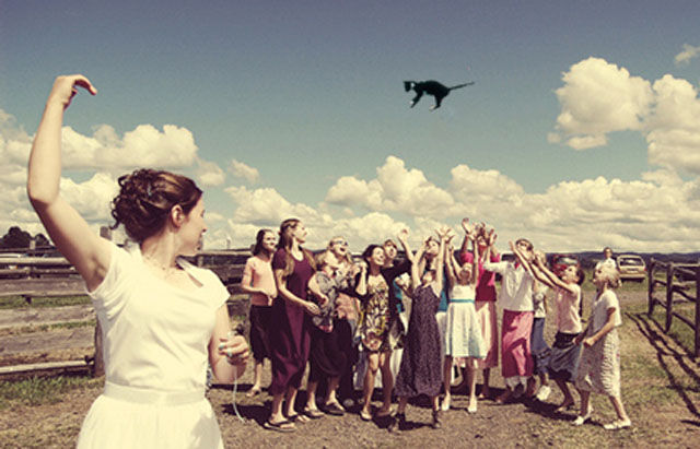 "Funny Snaps of the Bride ""Cat Toss"""