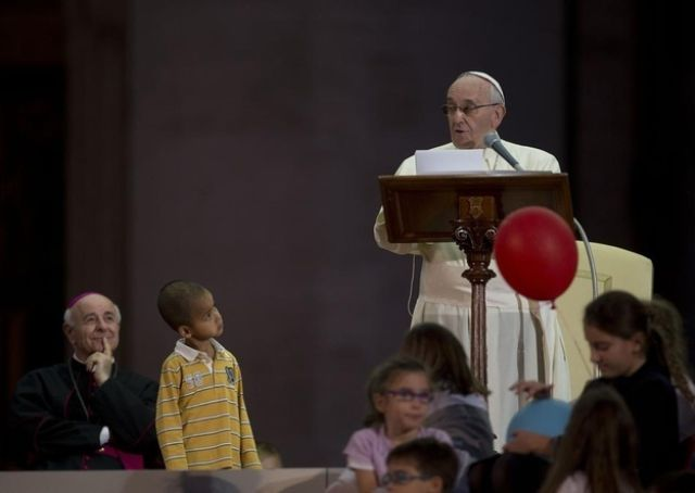 Pope Francis Gets a Visit Onstage from a Cute and Persistant Kid