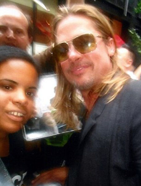 This Celebrity Fan Has the Most Photos with Stars Ever