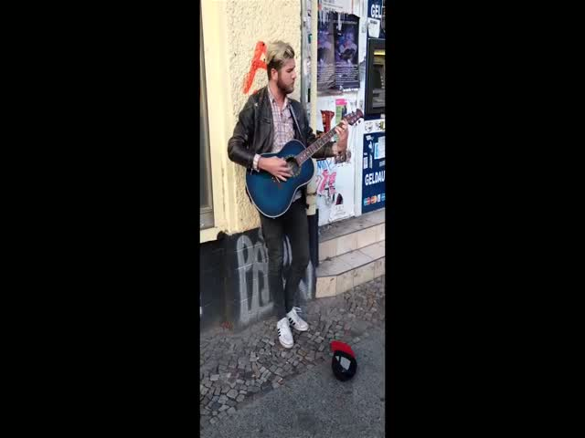 Star Runs into Street Musician Singing His Song, Joins Him