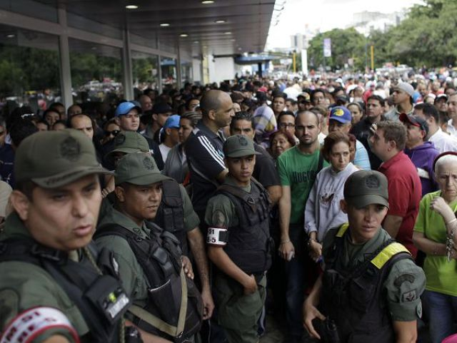 People Flock to Chain Stores for Bargain Shopping in Caracas