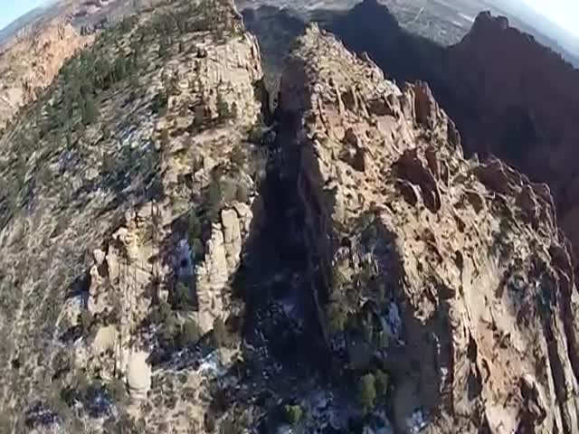 Mind-Blowing Wingsuit Flight through Narrow Canyon