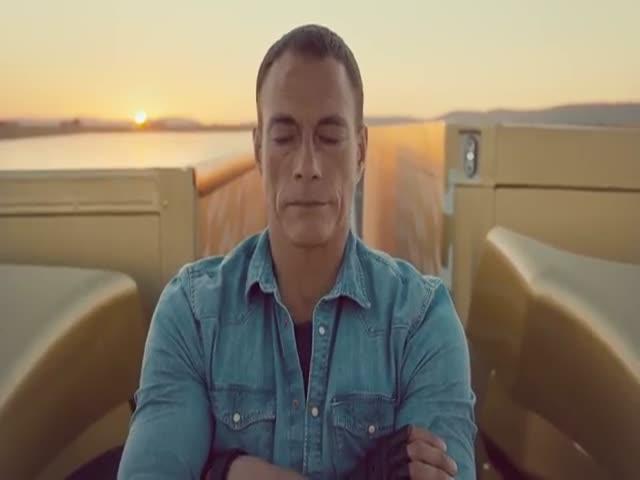 Jean-Claude Van Damme Does Epic Split between Two Moving Trucks