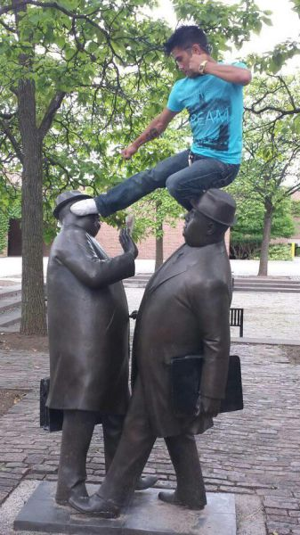 People Making a Mockery of Statues